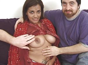 Indian with thick boobies and tatts receives cum shot