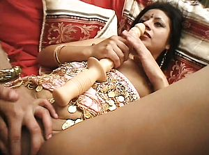 Two Indian honeys eat and finger each others moist fuckboxes and share a phat faux cock